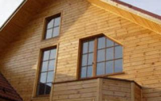 Использование имитации бруса для внешней и внутренней отделки дома